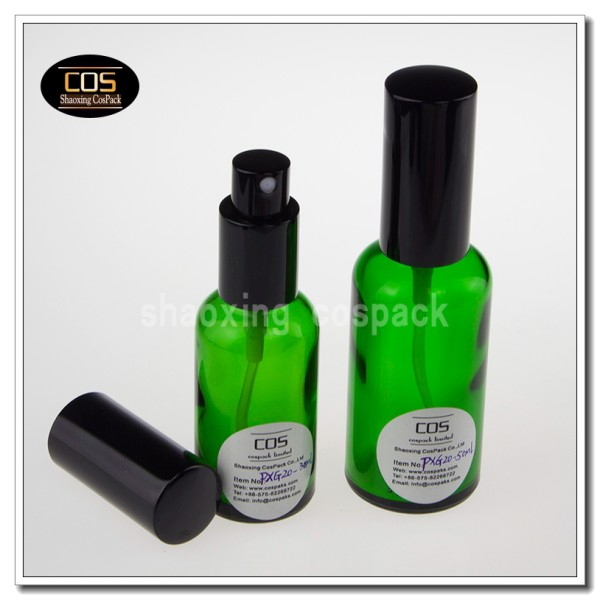 green colored spray bottles glass